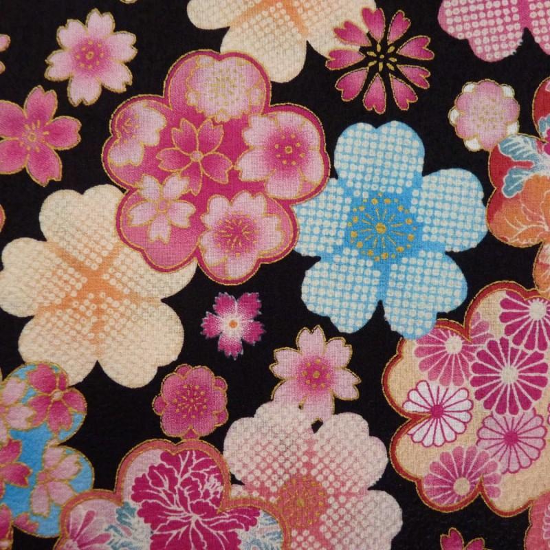 Tissu noir gaufré motifs de fleurs avec du doré