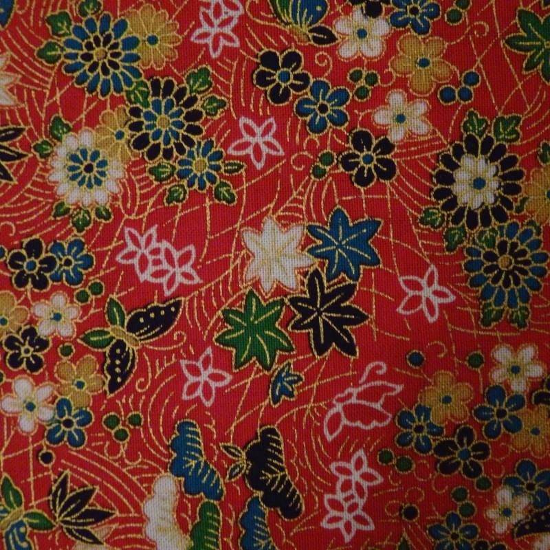Tissu rouge feuilles, papillons et fleurs