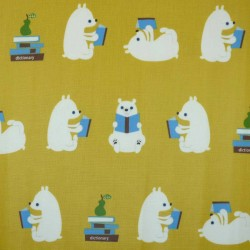 Laminated fabric bears and books on yellow background
