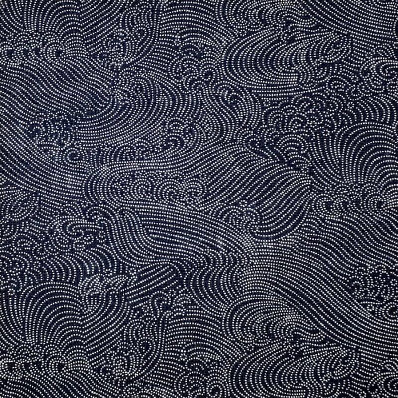 Japanese fabric waves in white dots on dark blue background