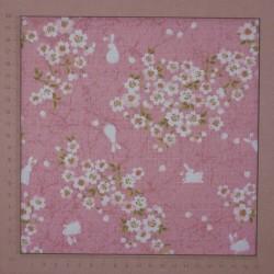 Tissu lapins et fleurs Pâques fond rose en coton