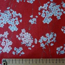 Tissu gaufré rouge motifs de petites fleurs de cerisier