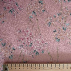 Tissu rose gaufré motifs de petites fleurs de cerisier
