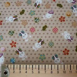 Tissu beige lapins fond motif asanoha