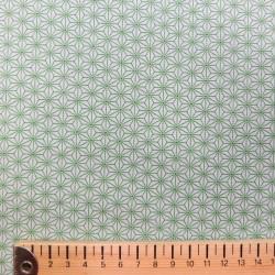 Tissu menthe pâle motifs petits asanoha verts