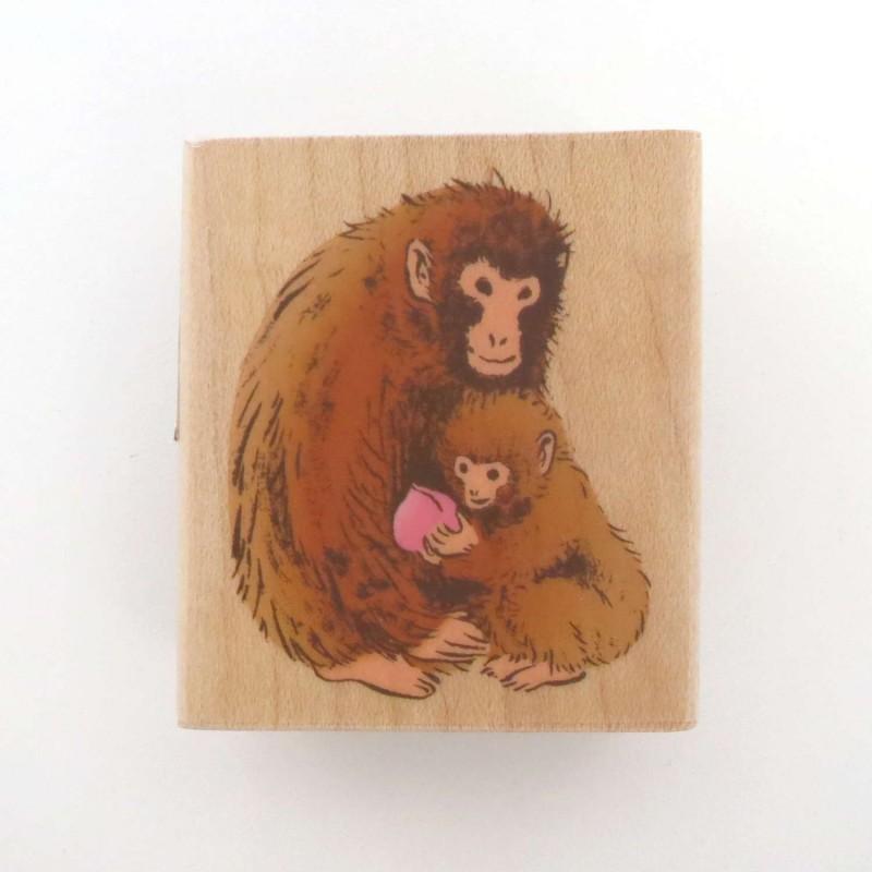Tampon singe japonais avec bébé et pêche