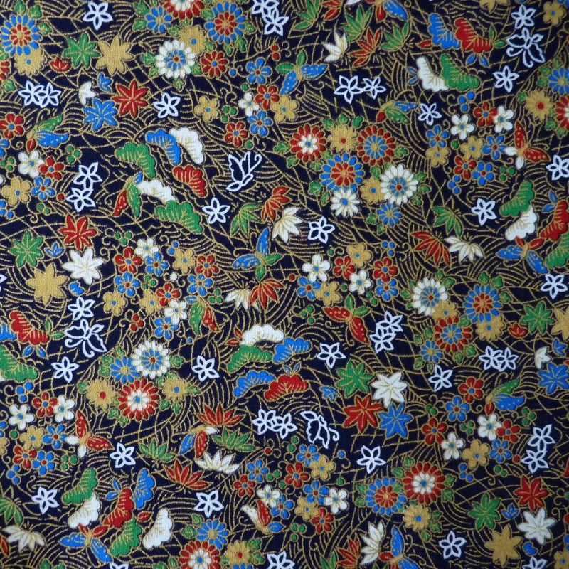 Tissu bleu nuit feuilles, papillons et fleurs