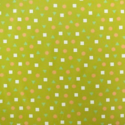 Mustard yellow corduroy with salmon pink circles, white squares and light green green triangle